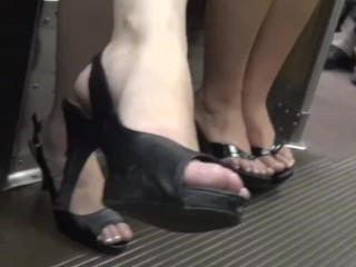 Candid girls' feet in sandals