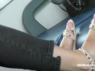 Candid feet and dirty soles on train chair