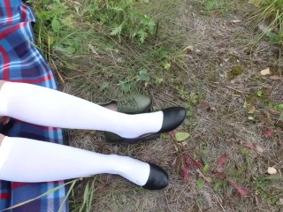 Schoolgirl in white socks changes shoes and shows her feet pantyhose knee socks