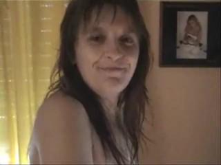 Mature woman masturbates in front of webcam